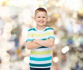 happiness, childhood, holidays and people concept - smiling little boy in casual clothes with crosse