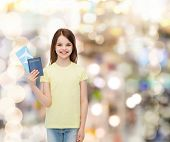 travel, holiday, vacation, childhood and transportation concept - smiling little girl with airplane