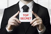 Businessan Holding Sign Top Secret