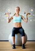 fitness, sport, training, future technology and lifestyle concept - smiling woman with dumbbells and