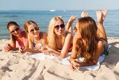 summer vacation, holidays, travel and people concept - group of smiling young women in sunglasses ly