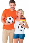 Excited football fan couple cheering at camera on white background