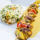 tasty grilled meat and vegetables skewers