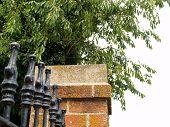 Decorative fence and brick column