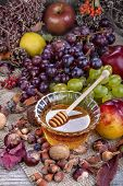 Autumn fruits and honey