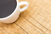 White Ceramic Coffee Cup On Wooden Table - View From Top
