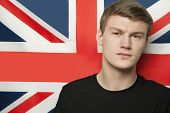 Portrait of young man against British flag