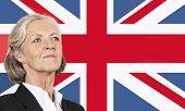 Close-up of senior businesswoman over British flag
