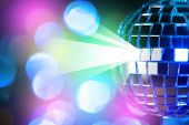 Blue shiny disco ball on Colorful and shine bokeh background