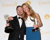 LOS ANGELES - AUG 25:  Aaron Paul, Anna Gunn at the 2014 Primetime Emmy Awards - Press Room at Nokia Theater at LA Live on August 25, 2014 in Los Angeles, CA
