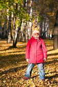 Children Throw Autumn Leaves