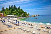 Beautiful city sand beach on Ionian Sea in Parga, Greece.