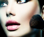 Makeup. Make-up Face. Big Make up brush. Beauty Woman. Makeup applying. Beautiful fashion model girl face closeup.