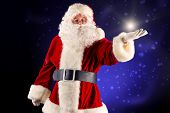 Portrait of a traditional Santa Claus. Over dark background. Christmas.