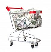 Shopping cart full of dollar notes