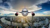 Passenger Airplane Landing On Runway In Airport