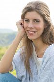 Portrait Of Young Woman Smiling Outdoor