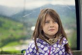 Upset Little Girl Riding In A Cable Car