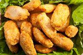 Chicken Nuggets on Fresh Salad Leaf