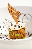 Salmon and Avocado Tartare. Topped with Cream Cheese and Crispy Bread