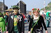 HASTINGS, ENGLAND - MAY 5, 2014: Costumed people assemble on the seafront for the parade through the Old Town at the annual Jack In The Green festival. The traditional event marks the May Day holiday.
