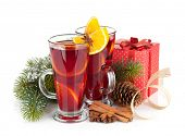 Christmas mulled wine with spices, gift box and snowy fir tree. Isolated on white background