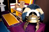 Rich Roman Helmet On Working Desk