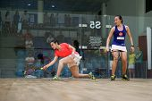AUGUST 19, 2014 - KUALA LUMPUR, MALAYSIA: Heba El Torky of Egypt (red) rushes forward to hit a retur