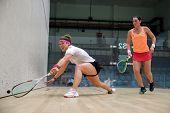AUGUST 19, 2014 - KUALA LUMPUR, MALAYSIA: Lisa Aitken plays Rachael Grinham of Australia (orange top
