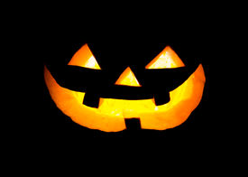 stock photo of scary face  - Halloween scary  pumpkin face glowing in dark  - JPG