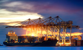 image of shipyard  - Container Cargo freight ship with working crane bridge in shipyard at dusk for Logistic Import Export background - JPG