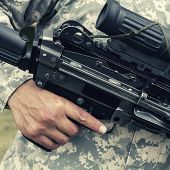 Soldier Holding Automatic Gun