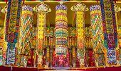 BYLAKUPPE, INDIA - FEBRUARY 10: Brightly decorated Buddhist temple in Namdroling Monastery in Bylakuppe, Karnataka, India on February 10, 2013