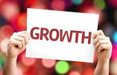 Growth card with colorful background with defocused lights