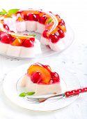 image of yogurt  - Fruit berry jelly and yogurt cake on plate - JPG