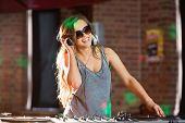 Pretty dj playing techno music at the nightclub