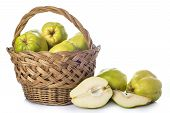 Basket With Quinces Isolated On White Background