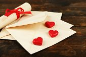 Love letters on rustic wooden table background
