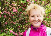 Portrait Of The Sports Woman Of Average Years At A  Blossoming Hawthorn