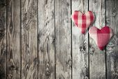 Two hearts decoration on wooden background