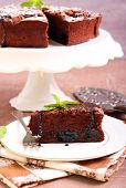 stock photo of torte  - Prune and chocolate torte slice - JPG
