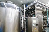 picture of boiler  - Water conditioning or distillation room with control panel equipment and water boiler or tank on pharmaceutical industry or chemical plant - JPG