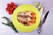 image of pangasius  - Dish of Pangasius fillet with rosemary and cherry tomatoes in plate on color wooden table background - JPG