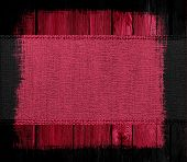 Maroon canvas textured on wood background