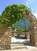 Постер, плакат: Stone Arch In The Historic Center Of Andorra La Vella