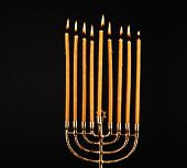 stock photo of hanukkah  - Hanukkah menorah with candles isolated on black - JPG
