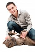 stock photo of pitbull  - Portrait of a happy young man with a pitbull puppy - JPG