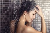 Woman Shampooing Her Long Brown Hair