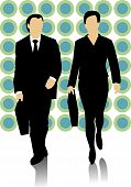 Male and female business people walking