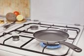 stock photo of flames  - empty pan on the stove burning flame - JPG